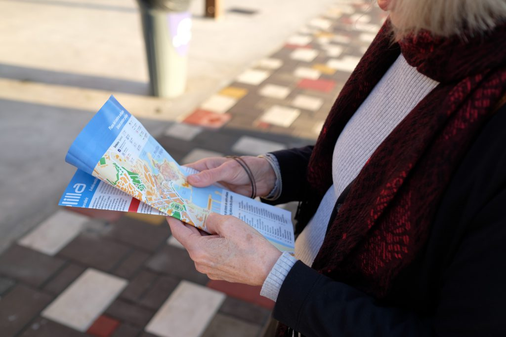 Airbnb guest holding a local neighbourhood map provided by the host