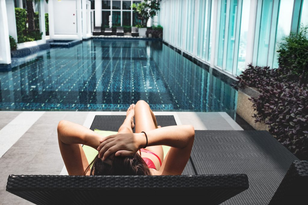 Airbnb Luxe: Women lying next to the pool