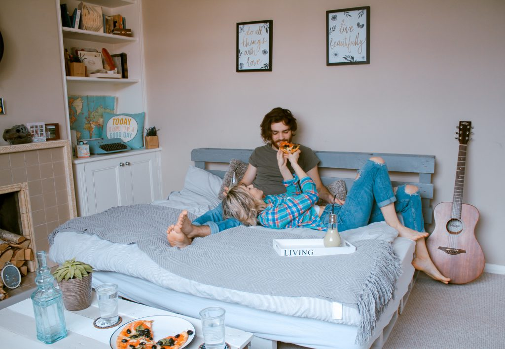 Airbnb Rental: Couple relaxing on a bed